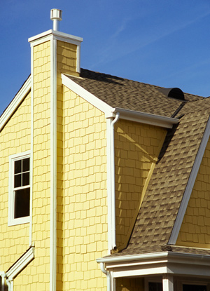 Yellow house with new roof